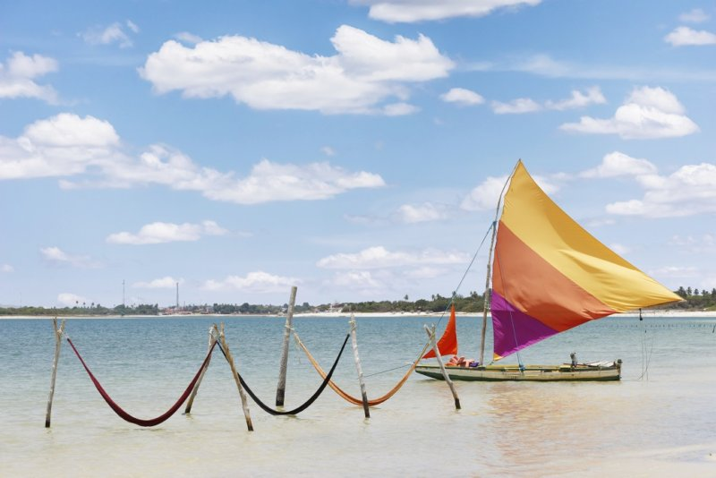 beautiful sail boat and hammocks at the Paradise Lake (Jericoacoara, Brazil)